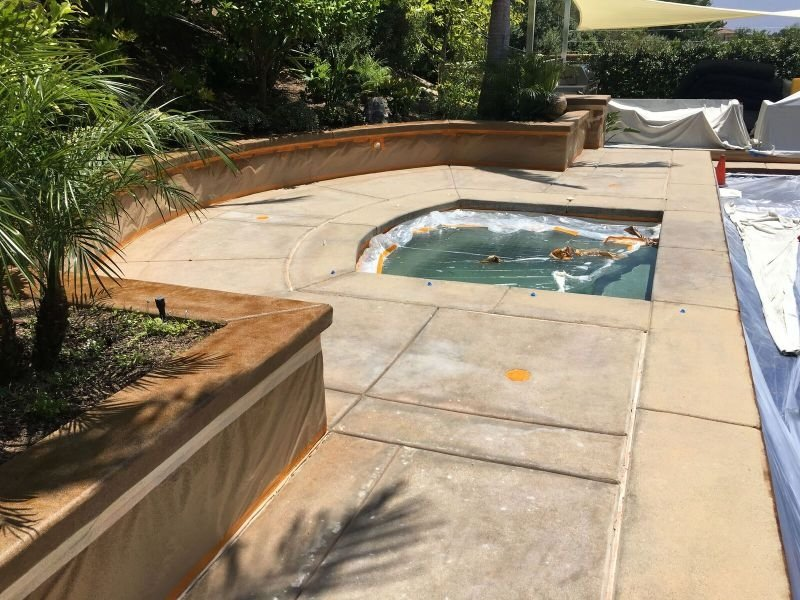 faded and discolored pool deck to be repaired