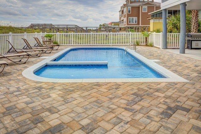 pool with brick stone paver