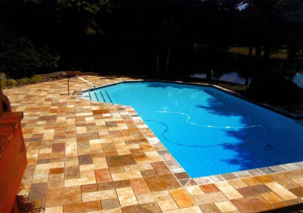 concrete-pool-deck-with-stamped-and-stained-coating-overlay